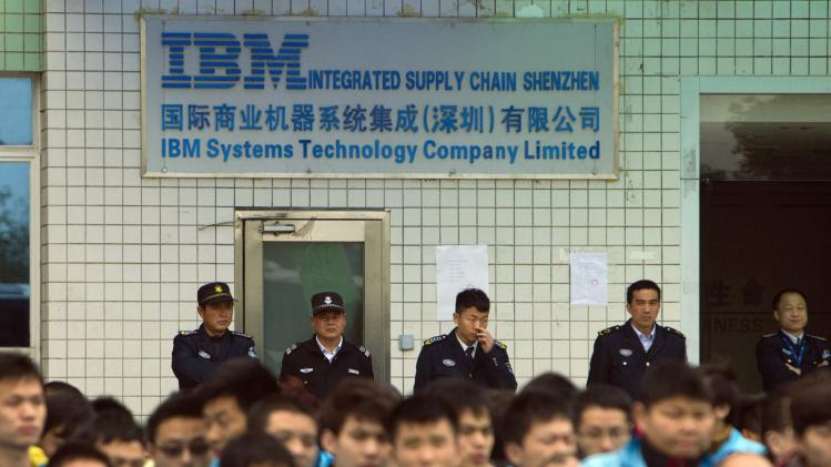 File photo of IBM workers protesting at an IBM factory in Shenzhen, Guangdong province