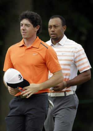 Rory McIlroy, left, of Northern Ireland, and Tiger Woods walk across the 10th green after putting during the second round of the U.S. Open golf tournament at Merion Golf Club, Friday, June 14, 2013, in Ardmore, Pa. (AP Photo/Gene J. Puskar)