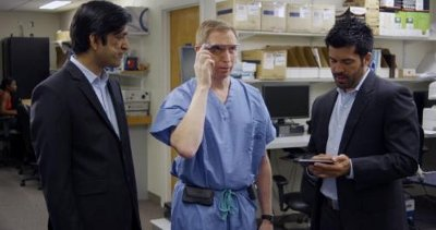 Developers Divya Mahajan from Philips and Brent Blum from Accenture instruct Dr. David Feinstein in how to use the Google Glass connected to IntelliVue monitoring.