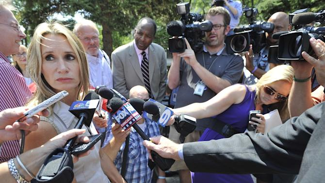 Stacy Peterson family spokesperson Pam Bosco speaks to the media outside the Will County Courthouse after the second day of the murder trial of Drew Peterson, Wednesday, Aug. 1, 2012 in Joliet, Ill.. Peterson, 58, is charged with killing his third wife, Kathleen Savio, in 2004. Her body was found in a dry bathtub in her home, her hair soaked with blood. He is also a suspect in the 2007 disappearance of his fourth wife, Stacy Peterson. (AP Photo/Paul Beaty)