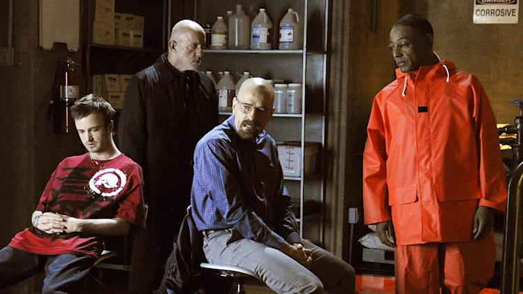 """This image released by AMC shows, from left, Jesse Pinkman, played by Aaron Paul, Mike Ehrmantraut, played by Jonathan Banks, Walter White, played by Bryan Cranston and Gustavo """"Gus"""" Fring, played by Giancarlo Esposito in a scene from season four of """"Breaking Bad."""" Any """"Breaking Bad """" fan could be forgiven for concluding that Sunday's finale held no major surprises. That's because this AMC drama series has delivered surprises, shock and OMG moments dependably since its premier five seasons ago. Just like it did on its final episode. (AP Photo/AMC, Ursula Coyote)"""