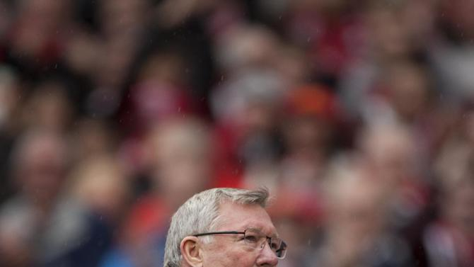 Manchester United's manager Sir Alex Ferguson applauds as he twalks from the pitch at half time during his last home game in charge of the club, their English Premier League soccer match against Swansea, at Old Trafford Stadium, Manchester, England, Sunday May 12, 2013. (AP Photo/Jon Super)