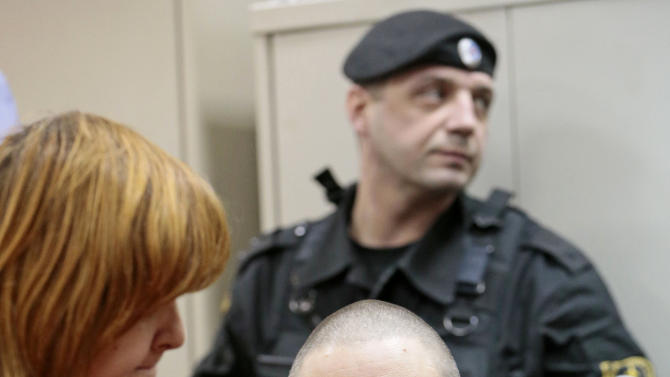 Russian opposition leader Sergei Udaltsov speaks with his lawyer Violetta Volkova, left, in a courtroom  in Moscow, Russia, Saturday, Feb. 9, 2013. Udaltsov, a top Russian opposition figure, has been placed under house arrest for two months, a move that also bans him from using most forms of communication, including the Internet, telephone and mail. A Moscow court imposed the restrictions Saturday on Sergei Udaltsov after prosecutors complained he had violated a previous agreement not to leave Moscow.  (AP Photo/Mikhail Metzel)