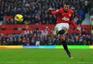 Manchester United's Dutch forward Robin van Persie takes the free-kick that led to United's second goal against Liverpool at Old Trafford on January 13, 2013. United manager Alex Ferguson plans to rest a number of key players for Wednesday's FA Cup replay with West Ham United as the English giants eye a treble success