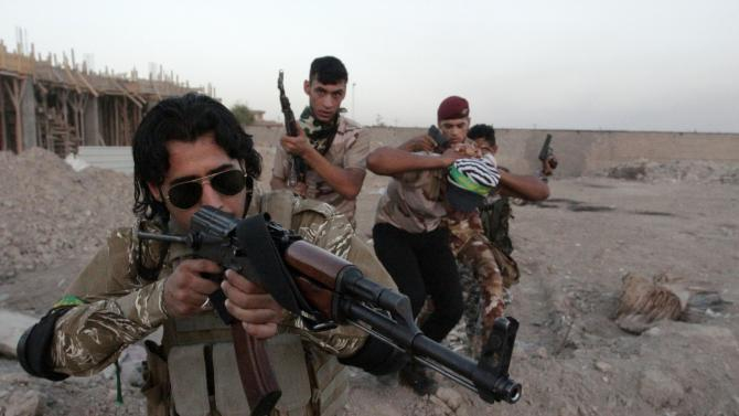 Shi'ite volunteers, who have joined the Iraqi army to fight ISIL, take part in a military-style training in Basra