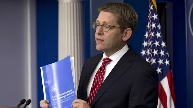 White House Press Secretary Jay Carney holds up a copy of the President's Plan for Economic Growth and Deficit Reduction, during his daily news briefing at the White House in  Washington, Thursday, Nov. 29, 2012, as President Barack Obama was having a private lunch with former Republican presidential candidate Mitt Romney. (AP Photo/Jacquelyn Martin)