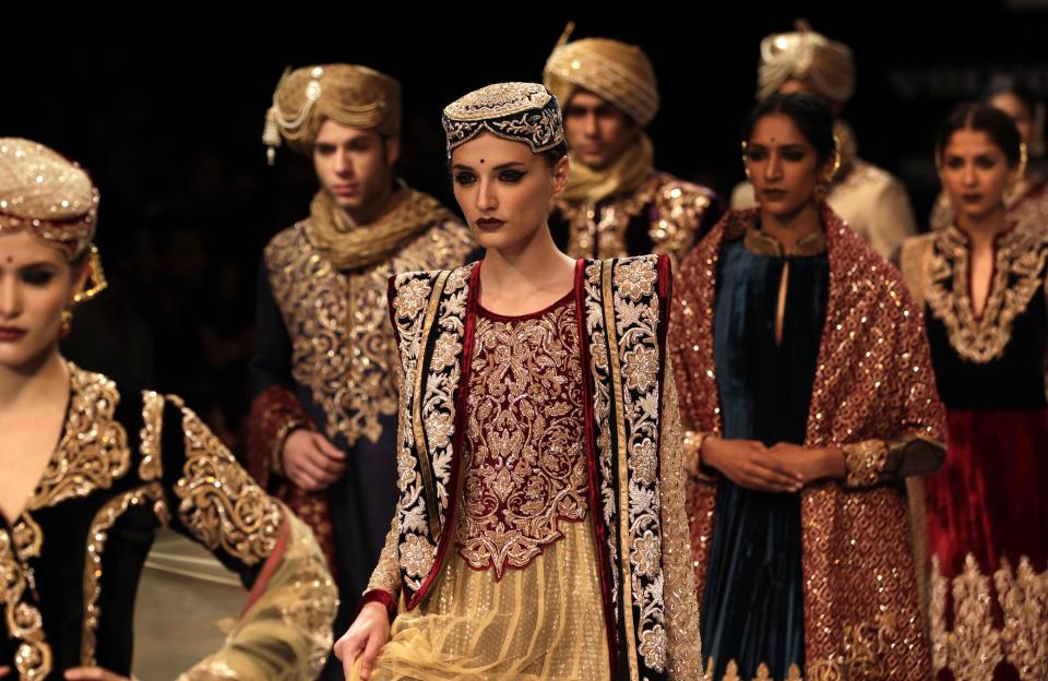 Indian models display creations by Shyamal and Bhumika during the Lakme Fashion Week in Mumbai, India, Monday, Aug. 6, 2012. (AP Photo/ Rajanish Kakade)