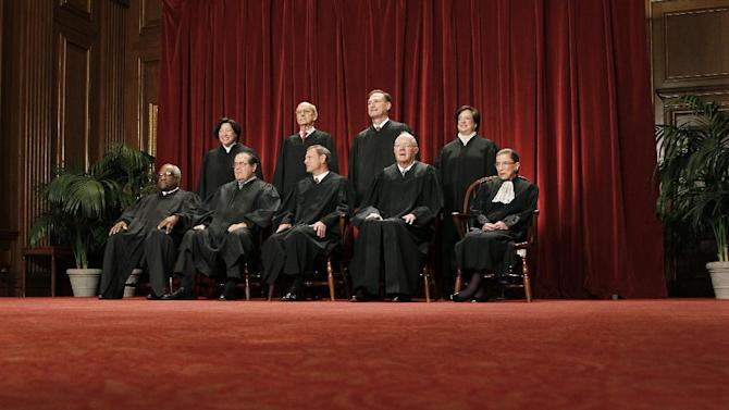 In this photo taken Oct. 8, 2012, the justices of the U.S. Supreme Court gather for a group portrait at the Supreme Court Building in Washington. The Supreme Court will begin hearing arguments on Monday morning, March 26, 2012, over President Barack Obama's health care overhaul, the Patient Protection and Affordable Care Act, his Obama's signature domestic achievement. Seated from left to right are: Associate Justice Clarence Thomas, Associate Justice Antonin Scalia, Chief Justice John G. Roberts, Associate Justice Anthony M. Kennedy, Associate Justice Ruth Bader Ginsburg. Standing, from left are: Associate Justice Sonia Sotomayor, Associate Justice Stephen Breyer, Associate Justice Samuel Alito Jr., and Associate Justice Elena Kagan. (AP Photo/Pablo Martinez Monsivais)
