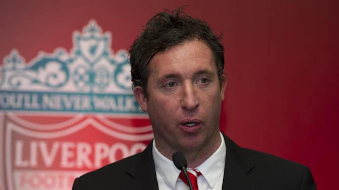 Former Liverpool Football Club and England striker Robbie Fowler speaks to media at an event in New Delhi on January 6, 2014