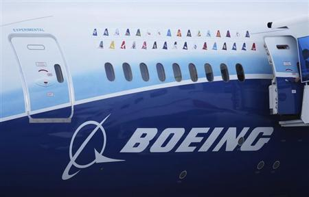 Logos of some Boeing 787 commercial airline clients are seen on a fuselage of the aircraft at the Singapore Airshow