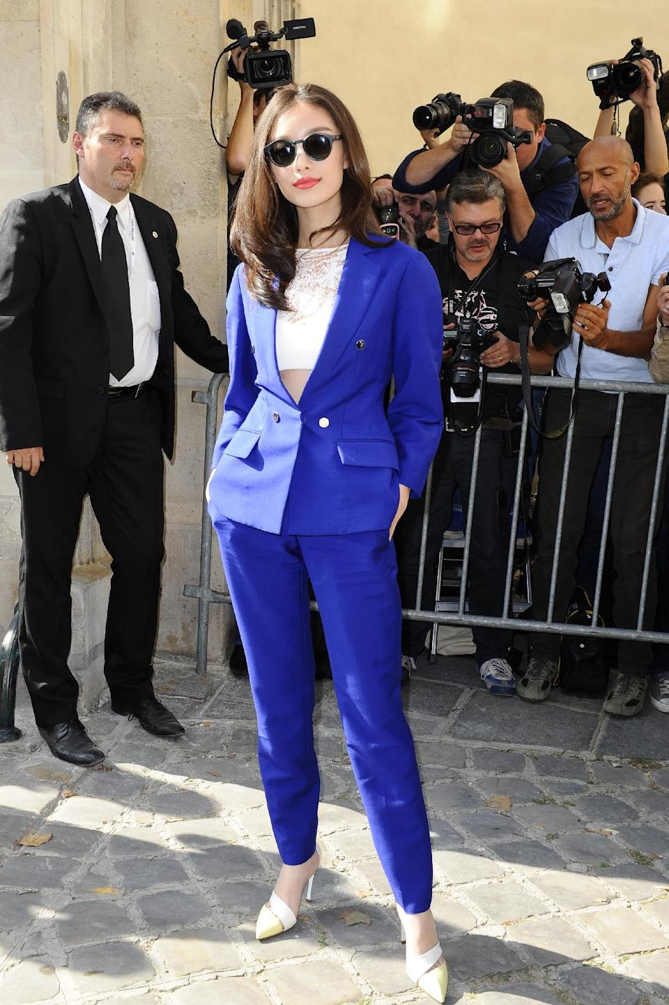 Actress Ni Ni arrives to attend Christian Dior's ready-to-wear Spring/Summer 2014 fashion collection, presented Friday, Sept. 27, 2013 in Paris. (AP Photo/Zacharie Scheurer)