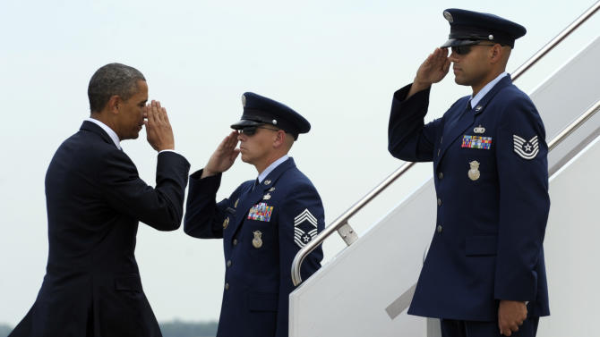 President Barack Obama walks to board Air Force One at Andrews Air Force Base in Md., Thursday, July 19, 2012. Obama is spending Thursday and Friday in Florida campaigning. (AP Photo/Susan Walsh)