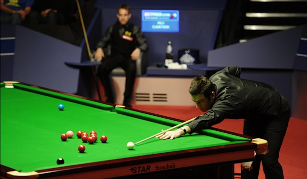 Ronnie O'Sullivan of England plays a shot during the second session of the World Championship Snooker final against Ali Carter of England at the Crucible Theatre in Sheffield, England on May 7, 2012.