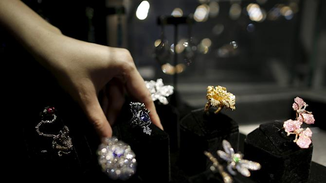 A shop assistant reaches for a ring, designed by Wendy Yue, at Plukka Store in Hong Kong, China