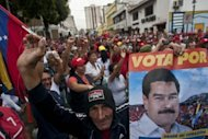 Supporters of Venezuelan President Nicolas Maduro demonstrate in Los Teques, on April 17, 2013. Maduro headed to a South American summit Thursday on the eve of his inauguration, blaming the opposition for deadly post-election violence as he deflected calls for a recount