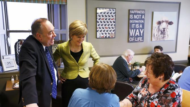 The leader of the Scottish National Party (SNP) Nicola Sturgeon and former leader and local candidate Alex Salmond chat to patrons in a cafe during campaigning in Inverurie, Aberdeenshire
