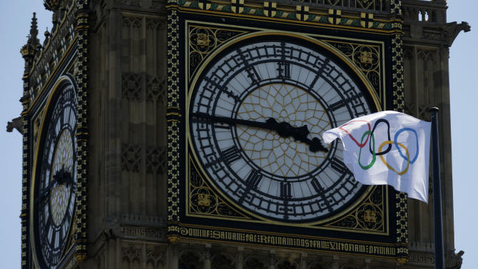 A Olympics flag flies in front of Big Ben Monday, July 23, 2012, in London. The 2012 London Olympics opening ceremonies are scheduled for Friday, July 27. (AP Photo/Charlie Riedel)