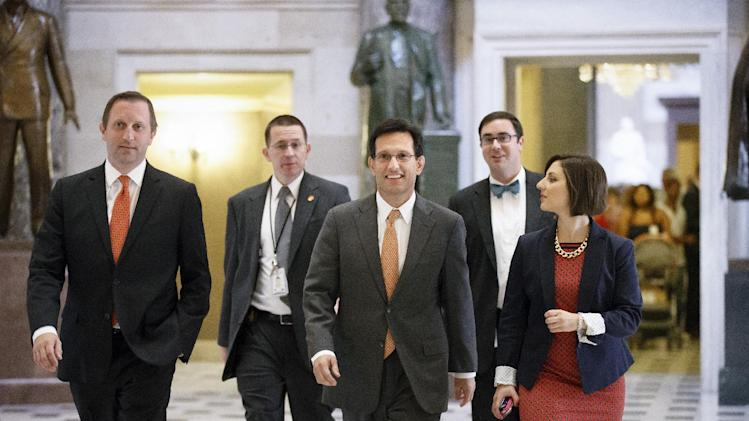 Majority Leader Eric Cantor, R-Va., is surrounded by his staff as he walks to the House chamber for votes, at the Capitol in Washington, Wednesday, July 30, 2014. As a result of his stunning primary defeat in the Virginia primary in June, Cantor will relinquish his leadership post tomorrow as Congress leaves for a five week recess. (AP Photo/J. Scott Applewhite)