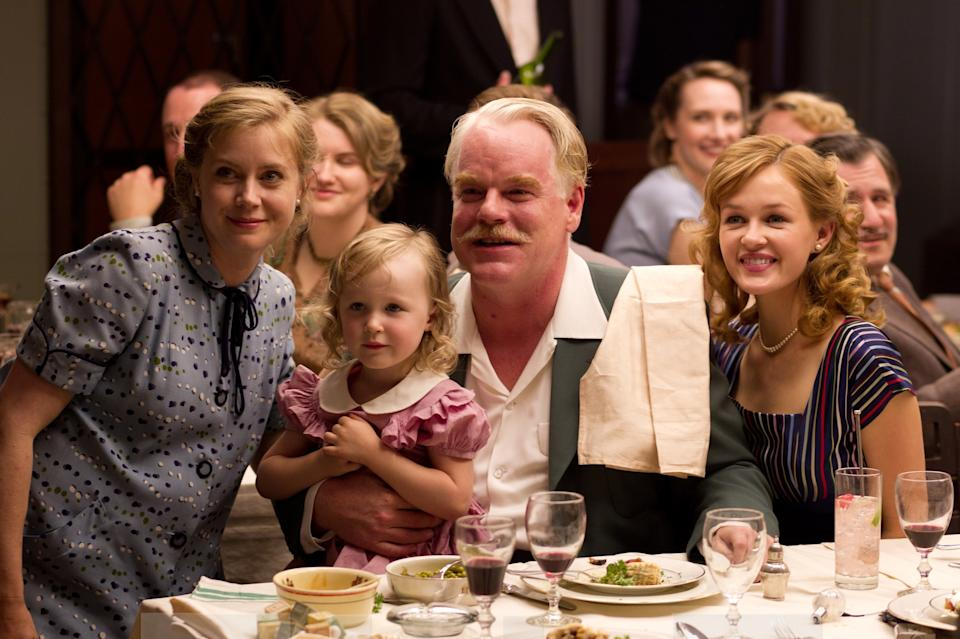"This film image released by The Weinstein Company shows Amy Adams, left, and Philip Seymour Hoffman, center, in a scene from ""The Master.""  The film will be presented at the 37th Toronto International Film festival running through Sept. 16. (AP Photo/The Weinstein Company)"