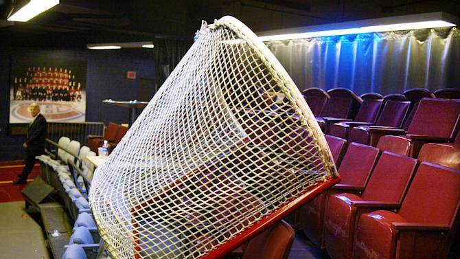 FILE - In this Sept. 16, 2004 file photo shows a hockey net lies atop seats under the stands at the Bell Centre,  home to the NHL's Montreal Canadiens, on the first day of the NHL players' lockout in Montreal. With a lockout drawing ever closer, the NHL and the players' union are in touch with each other after a day of internal meetings. But no new negotiating sessions are scheduled for Friday, Sept. 14, 2012, one day before Commissioner Gary Bettman has said he will lock out the players. This would be the NHL's fourth work stoppage since 1992.(AP Photo/The Canadian Press, Ian Barrett)