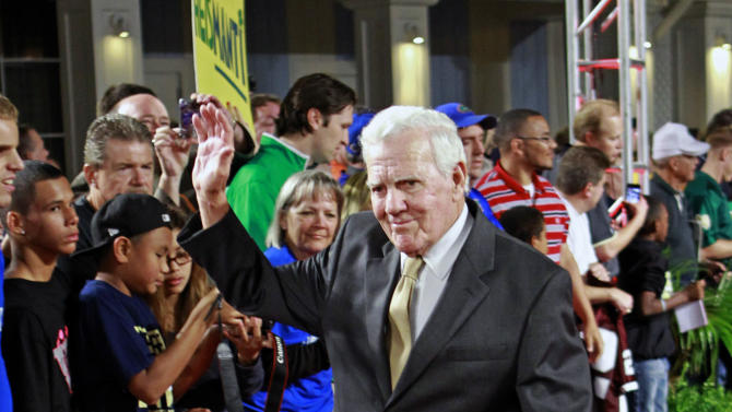 FILE - This Dec. 6, 2012 file photo shows former Notre Dame head coach Ara Parseghian waving to fans as he arrives at the Home Depot College Football Awards in Lake Buena Vista, Fla. Parseghian is nearly 90 years old, but he remembers the 1973 Sugar Bowl as if it happened yesterday. (AP Photo/John Raoux, File)