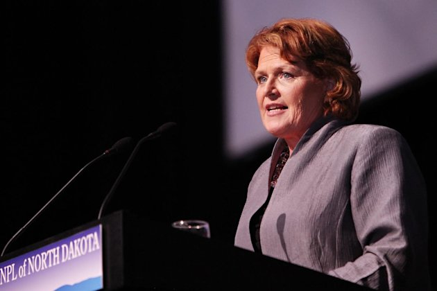 FILE - In this March 17, 2012 file photo, Heidi Heitkamp, the North Dakota Democratic Party's endorsed candidate for the U.S. Senate, speaks to delegates at the North Dakota Democratic state convention in Grand Forks, N.D. The constitutional win for President Barack Obama and Democrats on health care overhaul is reopening political cuts within the party over the unpopular law. Vulnerable Democratic incumbents and candidates, including Heitkamp, cautiously welcomed the court's judgment but argued that the law could be improved. (AP Photo/Shawna Noel Widdel, File)