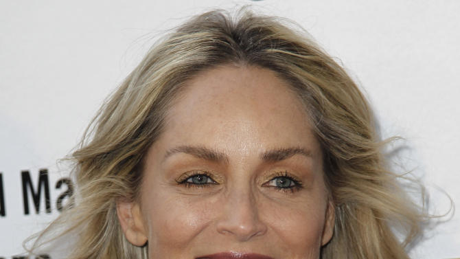 """FILE - In this Thurs., May 3, 2012 file photo, actress Sharon Stone arrives at A Better LA's """"In the Art of the City"""" event in Los Angeles. Stone was sued May 23, 2012 in Los Angeles by Erlinda T. Elemen, the actress' former nanny for allegedly insulting her Filipino heritage and firing her after discovering Elemen had been paid overtime for working on family vacations and holidays. (AP Photo/Matt Sayles, File)"""