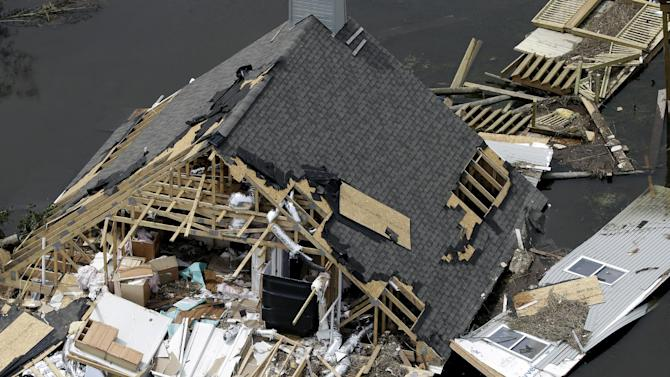 This aerial photo shows a home destroyed by Isaac in Yscloskey, La., Friday, Aug. 31, 2012. Isaac is now a tropical depression, with the center on track to cross Arkansas on Friday and southern Missouri on Friday night, spreading rain through the regions.(AP Photo/David J. Phillip)