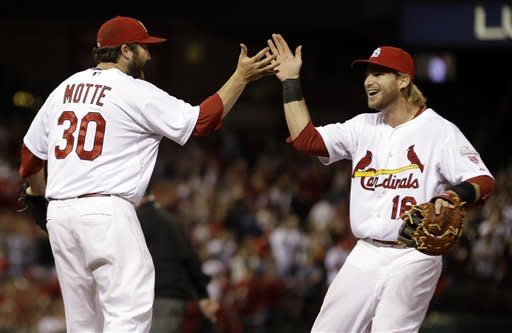 Miller strong in debut, leads Cards over Reds 1-0
