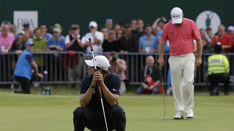 Adam Scott of Australia reacts after missing a putt on the 18th green at Royal Lytham & St Annes golf club during the final round of the British Open Golf Championship, Lytham St Annes, England Sunday, July  22, 2012. (AP Photo/Chris Carlson)