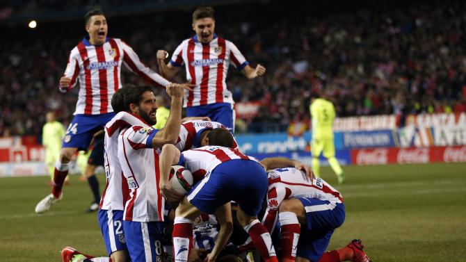 Atletico Madrid's players celebrate a goal during their Spanish King's Cup soccer match against Barcelona in Madrid