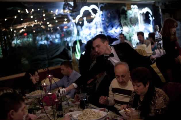 In this Feb. 3, 2012 photo, a waiter serves traditional Russian food at a seaside restaurant in Ashdod, a southern Israeli city heavily populated by immigrants from the former Soviet Union. (AP Photo/