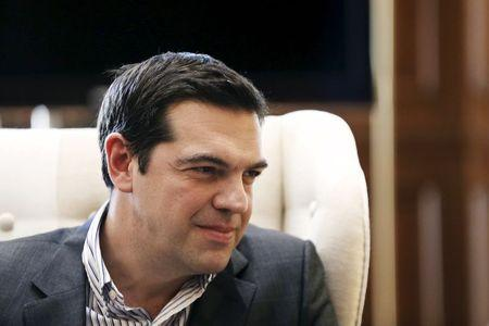 Greek PM Tsipras listens to Russian Gazprom CEO Miller during meeting in Athens