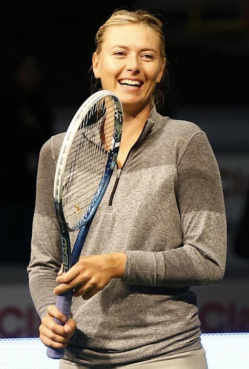 Russian tennis player Maria Sharapova smiles during a tennis clinic for children in Bogota, Colombia, Friday, Dec. 6, 2013. Sharapova will play Serbian Ana Ivanovic in an exhibition game Friday evenin