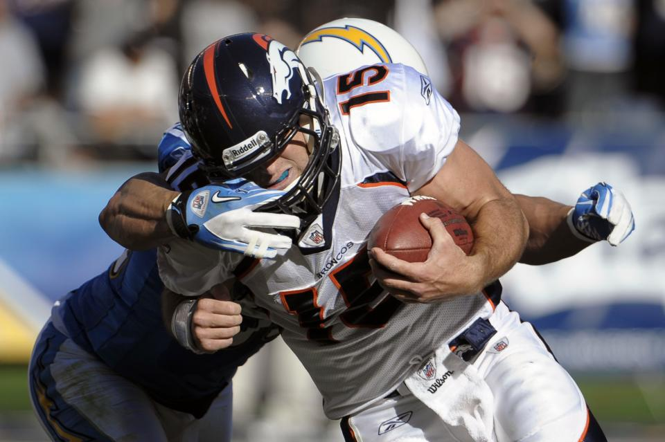 Denver Broncos quarterback Tim Tebow is tackled by San Diego Chargers outside linebacker Antwan Barnes during the first half of an NFL football game Sunday, Nov. 27, 2011, in San Diego. (AP Photo/Denis Poroy)