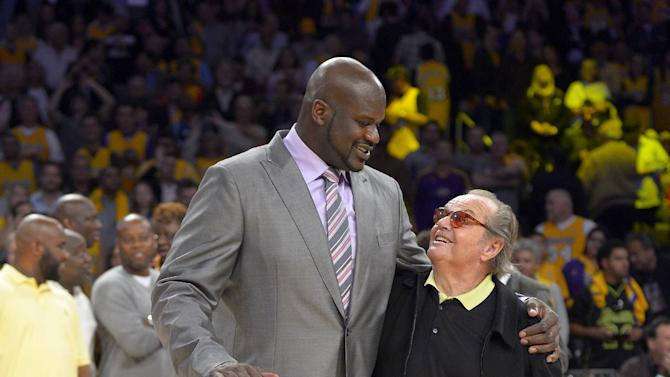 Former Los Angeles Lakers center Shaquille O'Neal stands with actor Jack Nicholson after they retired his jersey during the half of the Lakers'  NBA basketball game against the Dallas Mavericks, Tuesday, April 2, 2013, in Los Angeles. (AP Photo/Mark J. Terrill)