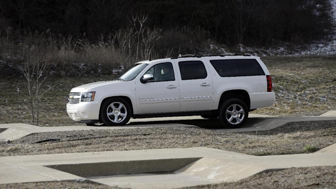 "In a Jan. 17, 2013 photo, a Chevrolet Suburban is driven through the uneven terrain course at the General Motors Milford Proving Grounds in Milford, Mich.  It's in this northwest Detroit suburb that GM has its testing facility, which, according to GM consumer affairs chief James Bell, exists for the purpose of beating ""the heck out of a vehicle before the customer can."" Founded in 1924, the 4,000-acre Milford Proving Grounds was the first dedicated automotive testing facility in the world, and remains one of the largest to this day. (AP Photo/Carlos Osorio)"