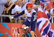 Britain&#39;s Victoria Pendelton celebrates after winning the gold medal in the London 2012 Olympic Games women&#39;s Keirin final track cycling event at the Veldorome in the Olympic Park in East London. Pendleton claimed her second Olympic title when she was crowned the inaugural women&#39; Olympic keirin champion