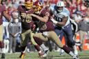 Washington Redskins quarterback Colt McCoy (16) scrambles during the second half of an NFL football game against the Tennessee Titans, Sunday, Oct. 19, 2014, in Landover, Md. (AP Photo/Pablo Martinez Monsivais)
