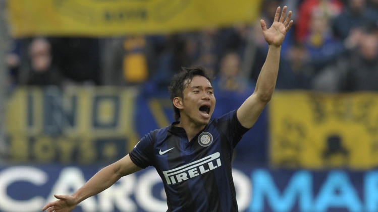 Inter Milan's Juto Nagatomo of Japan shouts during a Serie A soccer match against Parma, at Parma's Tardini stadium, Italy, Saturday, April 19, 2014