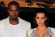 Kanye West and Kim Kardashian | Photo Credits: Mike Marsland/WireImage