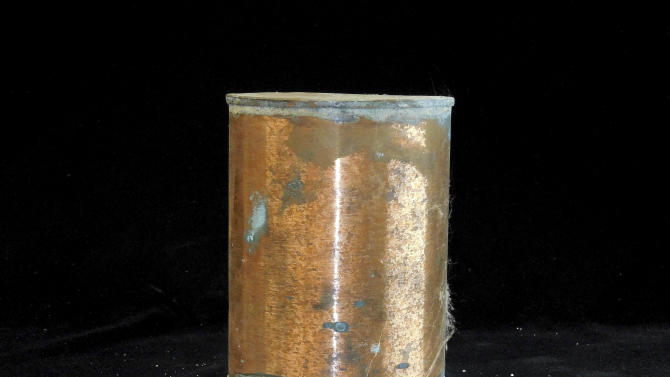 "In this undated photo provided by the Oregon State Hospital, a copper urn contains the cremated remains of S. Erickson, a former patient at the Oregon state mental hospital. More than 3,000 urns were discovered a decade ago and dubbed the ""forgotten souls."" A research effort to unearth their stories, and to reunite them with surviving relatives, takes center stage Monday, Juky 7, 2014 as officials dedicate a memorial to those patients who were never claimed. (AP Photo/Oregon State Hospital)"