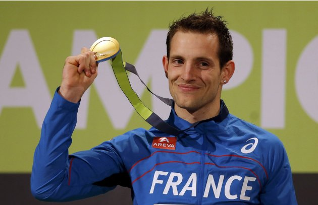 Winner Lavillenie of France shows his medal on the podium after the men's Pole Vault final at the European Athletics Indoor Championships in Gothenburg