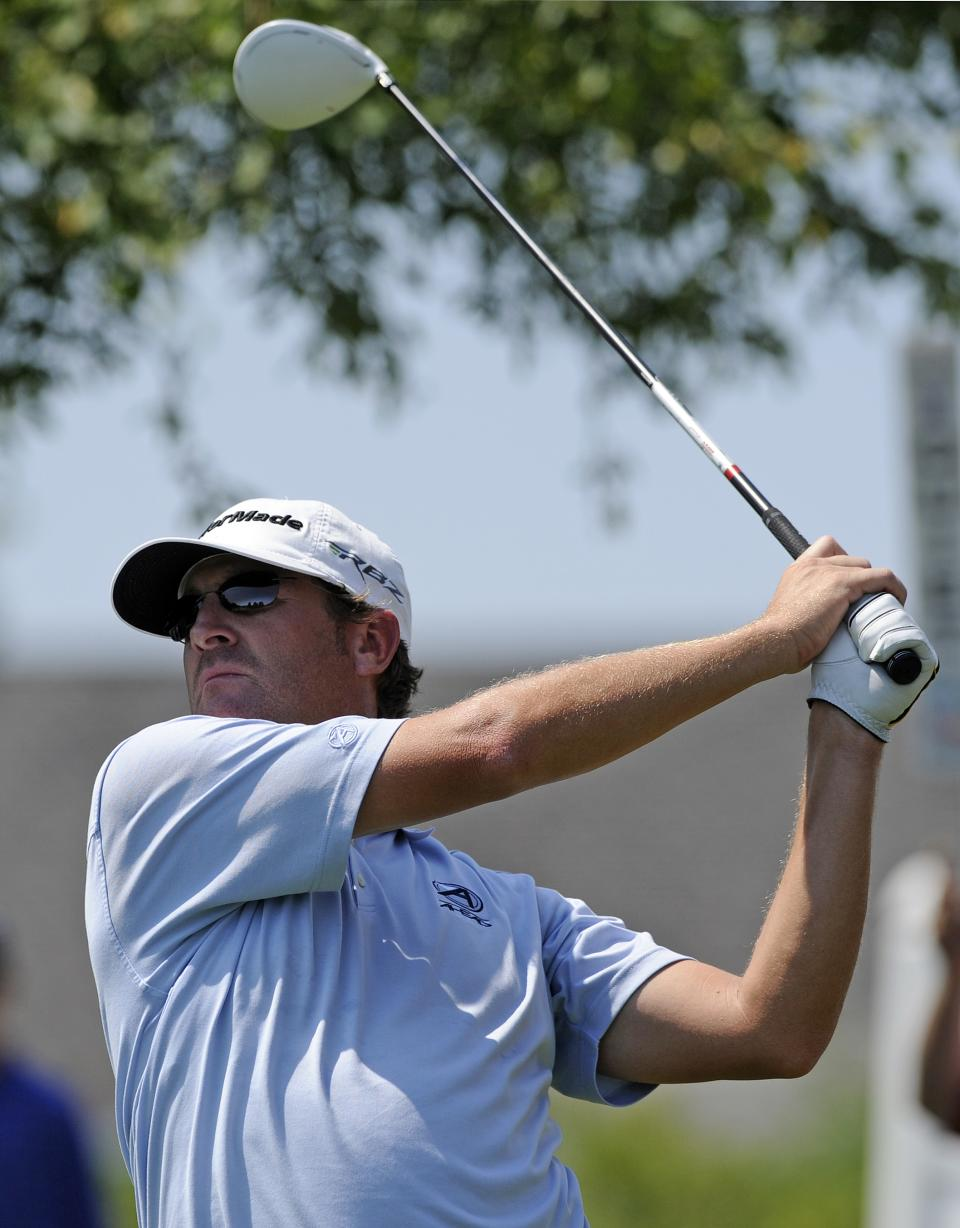 David Mathis watches his drive on the first hole during the first round of the Travelers Championship golf tournament in Cromwell, Conn., Thursday, June 21, 2012. Mathis finished in the lead at 6-under-par. (AP Photo/Fred Beckham)