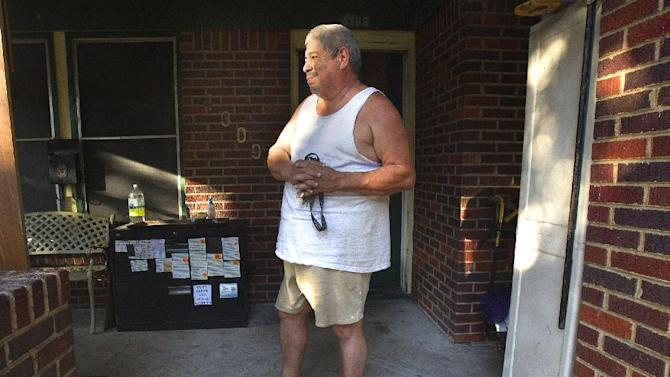 John Garcia stands in front of his home Sunday, Sept. 23, 2012, in Houston, where police say an officer shot and killed a one-armed, one-legged man in a wheelchair inside the group home. Police spokeswoman Jodi Silva said the man cornered the officer in his wheelchair and was making threats while trying to stab the officer with the pen. At the time, the officer did not know what the metal object was that the man was waving, Silva said. (AP Photo/Houston Chronicle, Cody Duty)