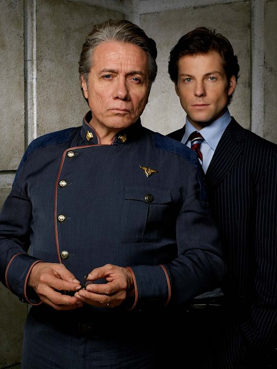 "Edward James Olmos as Admiral William Adama and Jamie Barber as Lee ""Apollo"" Adama in Battlestar Galactica on the Sci Fi Channel."