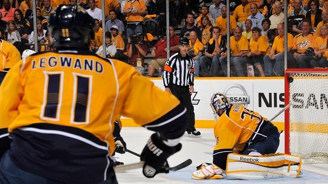 David Legwand #11 Of The Nashville Predators Wathces A Puck Go Into The Net Behind Goalie Pekka Rinne #35 Of The Getty Images