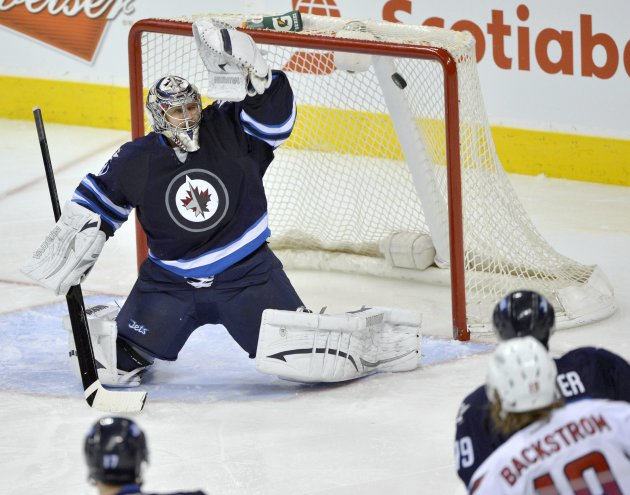 Capitals' Backstrom scores on Jets goaltender Pavelec during the third period of their NHL hockey game in Winnipeg
