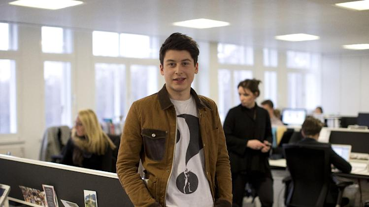 Nick d'Aloisio poses for photographs after being interviewed by The Associated Press in London, Tuesday, March 26, 2013.  One of Britain's youngest Internet entrepreneurs has hit the jackpot after selling his top selling mobile application Summly to search giant Yahoo.  Seventeen year old Nick d'Aloisio, who dreamed up the idea for the content shortening program when he was studying for his exams, said he was surprised by the deal. As with its other recent acquisitions, Yahoo didn't disclose how much it is paying for Summly, although British newspapers suggested the deal's value at several million dollars.  (AP Photo/Matt Dunham)