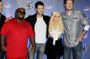 FILE - This Oct. 28, 2011 file photo shows, from left, Carson Daly, Cee Lo Green, Adam Levine, Blake Shelton, and Christina Aguilera, from the reality television competition &quot;The Voice&quot;, in Culver City, Calif. The NBC singing contest said Friday that Christina Aguilera and Cee Lo Green would return for The Voice Season 5, joining Adam Levine and Blake Shelton. Their midseason replacements _ Shakira and Usher _ will be back for Season 6, which will air in midseason 2014. (AP Photo/Matt Sayles, file)